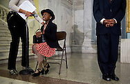 """Ravyn Bias, 9, portraying Rosa Parks, gets help adjusting her microphone while Everett Evans-Kearney, 12, as Martin Luther King Jr., stands in position before giving the mayor a sneak preview of the annual """"Blacks in Wax"""" performance. (photo by Barbara L. Salisbury/The Washington Times)"""