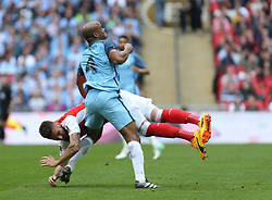 23 April 2017 FA Cup semi-final : Arsenal v Manchester City :<br /> Olivier Giroud of Arsenal falls as he is challenged by Vincent Kompany.<br /> Photo: Mark Leech