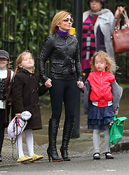 Former Spice Girl, Geri Halliwell dress from head to toe in black picking up her daughter Bluebell Madonna from school. London, UK. 07/03/2013 <br />