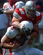 MORNING JOURNAL/DAVID RICHARD<br />Ohio State linebacker Bobby Carpenter sacks quarterback Josh Betts of Miami yesterday in the first quarter.