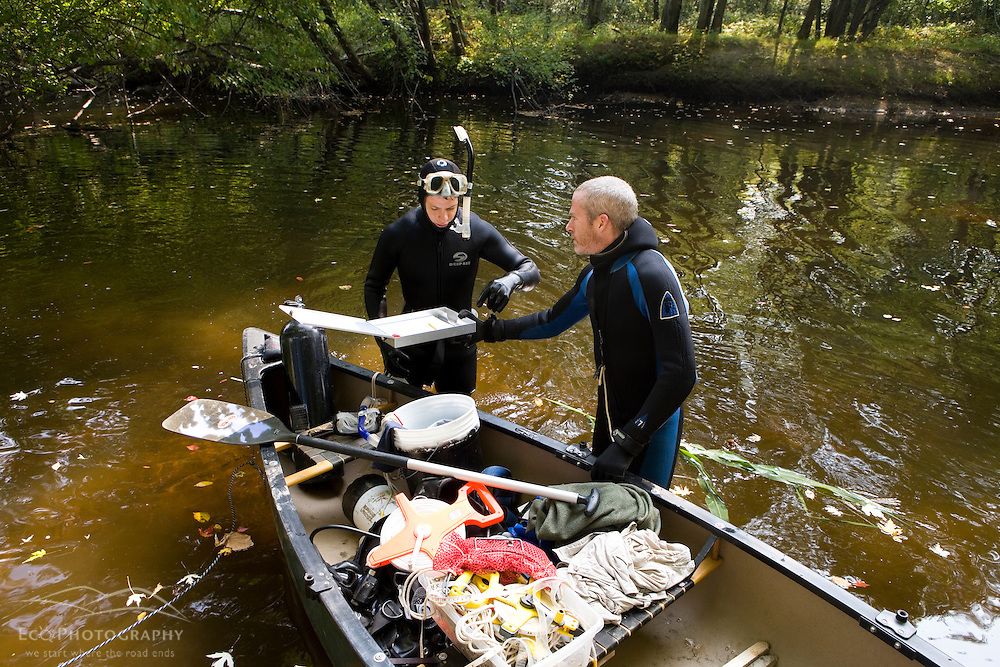 Mussel reasearchers Ehtan Nedeau (right) and Carson Mitchell in the Ashuelot River, Keene, New Hampshire.