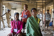 A mother and her children in the building site outside the crèche of the Veera Desai Centre in Mumbai. The centre is 1 of 70 crèche's in India run by the Mumbai Mobile Crèche organisation.