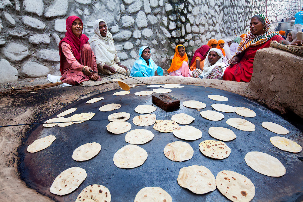 Volunteers make Roti in a sikh temple,Punjab, India. There are hundreds of volunteers  that help produce tens of thousands of free meals everyday!