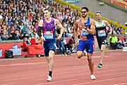 Yasmani Copello (TUR), right, leads David Kendziera (USA) on his way to winning the men's 400m hurdles in a time of 49.08 during the Birmingham Grand Prix, Sunday, Aug 18, 2019, in Birmingham, United Kingdom. (Steve Flynn/Image of Sport via AP)