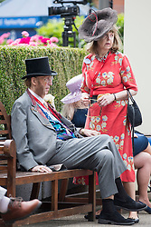 © Licensed to London News Pictures. 19/06/2018. London, UK.  Former race commentator John McCririck and his wife Jenny McCririck  attend day one of Royal Ascot at Ascot racecourse in Berkshire, on June 19, 2018. The 5 day showcase event, which is one of the highlights of the racing calendar, has been held at the famous Berkshire course since 1711 and tradition is a hallmark of the meeting. Top hats and tails remain compulsory in parts of the course. Photo credit: Ben Cawthra/LNP