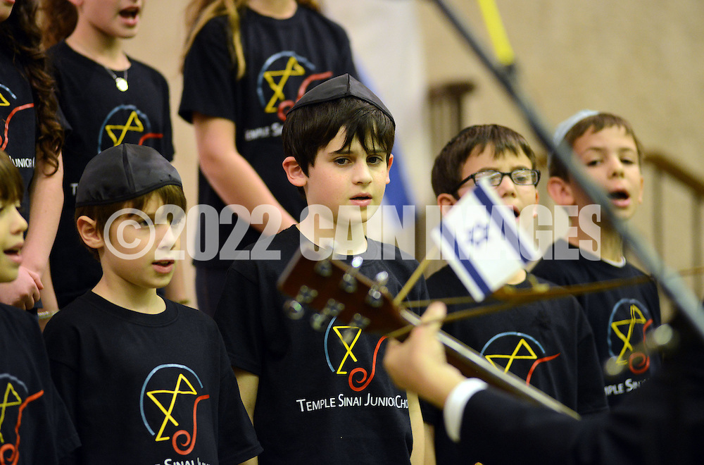 DRESHER, PA -  DECEMBER 10:  The Temple Sinai Junior Choir performs during STANDING UNITED WITH ISRAEL An Evening Dedicated to Demonstrating our Support for Israel December 8, 2013 at Temple Sinai in Dresher, Pennsylvania. (Photo by William Thomas Cain/Cain Images)
