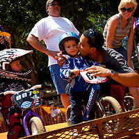 SARASOTA, FL -- April 23, 2011 -- Orlando Paulino kisses his son, Aviel, 3, at the starting point of the Strider bike races during the National Bicycle League (NBL) Easter Classic in Sarasota, Fla., on Saturday, April 23.  Sarasota County Parks and Recreation and the Sarasota Convention and Visitors Bureau sponsored the event which drew over 1,000 riders and their fans to the area this weekend.  (PHOTO / CHIP LITHERLAND)