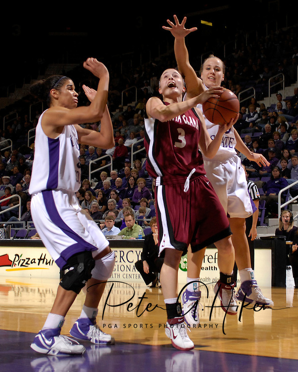 Santa Clara guard Chandice Cronk (3) drives to the basket against pressure from Kansas State's Kimberly Dietz (R) and Marlies Gipson (L) in the first half at Bramlage Coliseum in Manhattan, Kansas, December 15, 2006.  K-State defeated Santa Clara 76-52.<br />