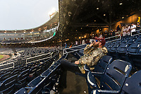 Cody Cox of Paragould, Arkansas, drinks a beer as rain delays game one of the College World Series title series at TD Ameritrade Park on Monday, June 25, 2018, in Omaha.<br /> <br /> MATT DIXON/THE WORLD-HERALD