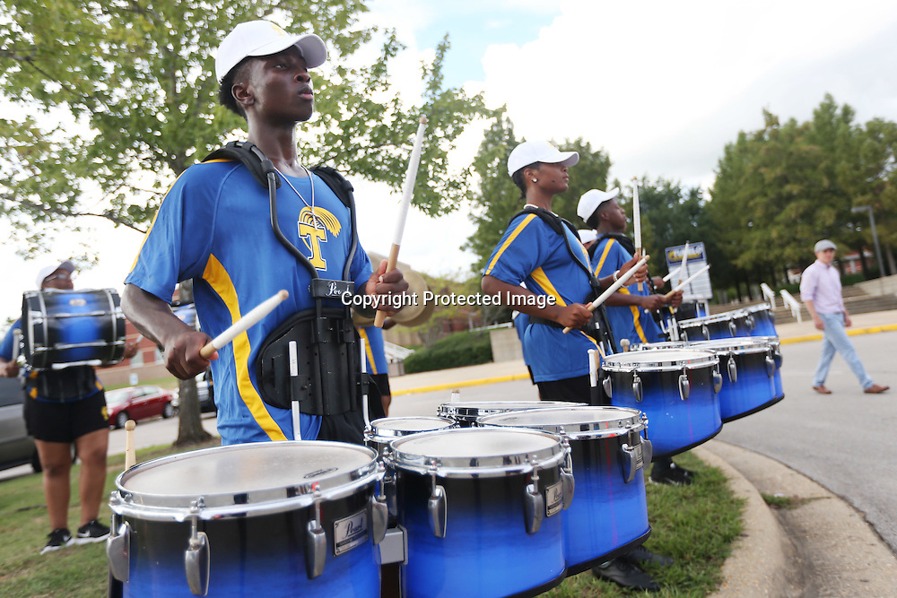 Lauren Wood | Buy at photos.djournal.com<br /> K.J. Hereford plays the quad drums as he and other members of the Tupelo High School drumline practice before the start of Friday night's season opener game at home against Clarksdale.