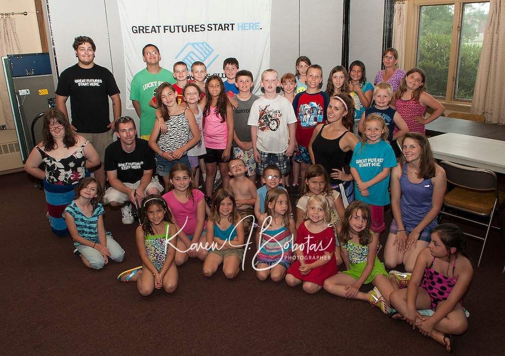 """Children of the Boys and Girls Club begin their first week in their new """"home"""" on North Main Street in Laconia.  (Karen Bobotas/for the Laconia Daily Sun)"""