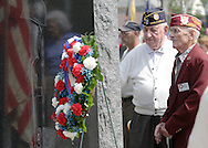 Town of Wallkill, NY - Two elderly World War II veterans look at new World II monument unveiled during a Memorial Day ceremony on May 25, 2009.