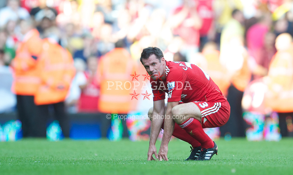 LIVERPOOL, ENGLAND - Sunday, August 15, 2010: Liverpool's Jamie Carragher looks dejected after his side's 1-1 draw with Arsenal during the Premiership match at Anfield. (Pic by: David Rawcliffe/Propaganda)
