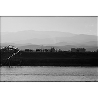 Farmers returning home from work along the bank of the Mekong River, Xishuanbana, Yunan, China.