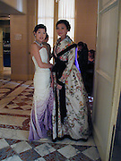 Penelope Tang and Candy  Soo (Taller)  , Getting ready on the Friday, Thirteenth Annual Crillon Haute Couture Bazll. Paris, © Copyright Photograph by Dafydd Jones 66 Stockwell Park Rd. London SW9 0DA Tel 020 7733 0108 www.dafjones.com