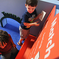 Adam Robison | BUY AT PHOTOS.DJOURNAL.COM<br /> ECEC pre-k students Jacob Bell and Kingston Copeland play the match game in the interactive art sculoture/exhibit Thursday during class. The match game uses familiar pictures for children hone their skills as they engage in pre-reading matching practice.