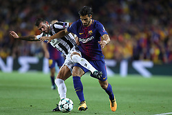 September 12, 2017 - Barcelona, Spain - Andre Gomes of FC Barcelona duels for the ball with Stefano Sturaro of Juventus during the UEFA Champions League, Group D football match between FC Barcelona and Juventus FC on September 12, 2017 at Camp Nou stadium in Barcelona, Spain. (Credit Image: © Manuel Blondeau via ZUMA Wire)