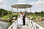 Bride and groom standing on the foot bridge to the gazebo on Hiawatha Lake at Onondaga Park, Syracuse, NY