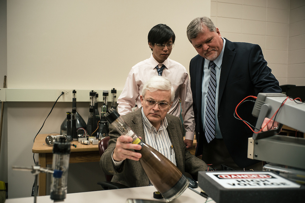"AUBURN, AL – NOVEMBER 20, 2016: Tony Overfelt (center) examines an antique cathode ray tubes from a television set for use in an additive manufacturing experiment. In 2016, Auburn University received a grant to develop low cost additive manufacturing techniques, which would allow small businesses interested in additive manufacturing to cheaply test the method's viability for their unique production needs. By repurposing the infrastructure inside cathode ray tubes, the existing electron gun inside the tubes is harnessed for additive manufacturing. ""All the infrastructure used in the million dollar machines is right here in these tubes,"" Prorok said. ""It's more crude, and tuned to a different application, but it's there. We're trying to harness them to do something new."" Prorok believes the method has potential to become the new paradigm for how newer additive manufacturing machines are built.<br /> <br /> In much of the United States, global trade and technological innovation has failed to produce the prosperity hoped for by political and business leaders. Yet despite formidable economic challenges, some localities are flourishing. In Lee County, Ala., unemployment is below the national average despite the loss of thousands of manufacturing jobs, and the key to the county's resilience may be Auburn University, which provided a steady source of employment during recessions and helped draw new businesses to replace those that fled. CREDIT: Bob Miller for The Wall Street Journal<br /> [RESILIENT]"