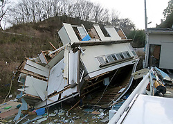 London News Pictures. 20/03/2011. This shop was turned onto its roof by the force of the Tsunami in Onagawa, Japan. Thousands are missing after a 9.0 magnitude strong earthquake struck on March 11 off the coast of Japan causing a tsunami wave.Photo credit should read: Alex Tee/London News Pictures