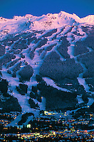 Blackcomb Mountain at twilight in winter rises up from the valley of Whistler, BC Canada