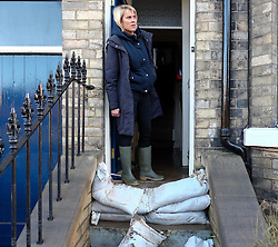 © Licensed to London News Pictures. 29/12/15<br /> York, UK. <br /> <br /> Kate Maughan-Brown looks out of the door of her flooded house as flood water begins to subside on Huntington Road in York. Further rainfall is expected over coming days as Storm Frank approaches the east coast of the country.<br /> Photo credit : Ian Forsyth/LNP