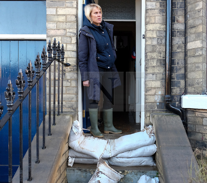 &copy; Licensed to London News Pictures. 29/12/15<br /> York, UK. <br /> <br /> Kate Maughan-Brown looks out of the door of her flooded house as flood water begins to subside on Huntington Road in York. Further rainfall is expected over coming days as Storm Frank approaches the east coast of the country.<br /> Photo credit : Ian Forsyth/LNP