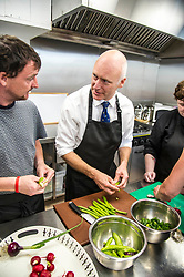 Pictured: Mr FitzPatrick was joined at the preparation table by volunteer David Keogh,<br /> <br /> New Public Health Minister Joe FitzPatrick visited Bridgend Inspiring Growth centre, Bridgend Farmhouse in Edinburgh to launch the Scottish Government's diet and healthy weight delivery plan. <br /> <br /> Mr FitzPartick joined volunteers to prepare some salad for today's lunch.<br /> <br /> Ger Harley | EEm Date