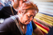 28 APRIL 2014 - BANGKOK, THAILAND:  A woman in grief tries to reach the coffin during the funeral for Kamol Duangphasuk, 45, in Bangkok. Kamol was a popular poet who wrote under the pen name Mai Nueng Kor Kunthee. Kamol had been writing since the 1980s and was an outspoken critic of the 2006 coup that deposed Thaksin Shinawatra. After the 2010 military crackdown against the Red Shirts he went into temporary self imposed exile fearing for his safety. After he returned to Thailand he organized weekly protests against Thailand's Lese Majeste laws, which he said were being used to stifle dissent. Kamol was shot and murdered on April 23. The assailants are still at large but the murder is thought to be political.    PHOTO BY JACK KURTZ