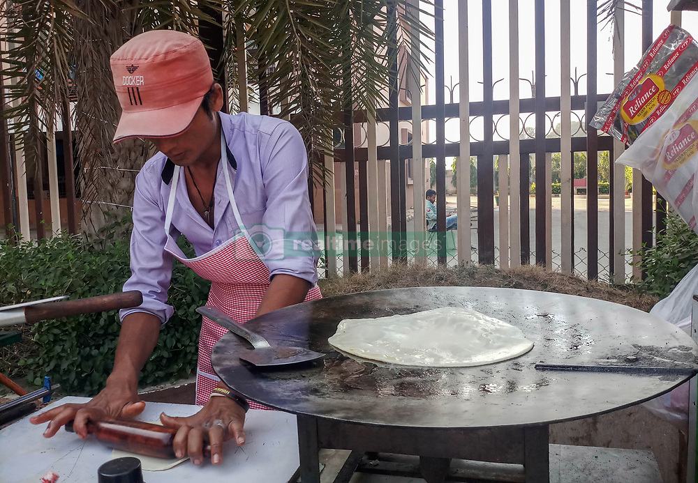 November 18, 2018 - Chandigarh, Punjab, India - An Indian vendor seen preparing chapati (flat bread) at a temporary roadside stall in Chandigarh..Chandigarh is a city and a union territory in India that serves as the capital of the two neighbouring states of Haryana and Punjab. Chandigarh is bordered by the state of Punjab to the north, the west and the south, and to the state of Haryana to the east. (Credit Image: © Saqib Majeed/SOPA Images via ZUMA Wire)