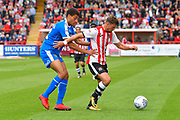 Lee Holmes (10) of Exeter City battles for possession with Christian Oxlade-Chamberlanin (12) of Notts County during the EFL Sky Bet League 2 match between Exeter City and Notts County at St James' Park, Exeter, England on 8 September 2018.
