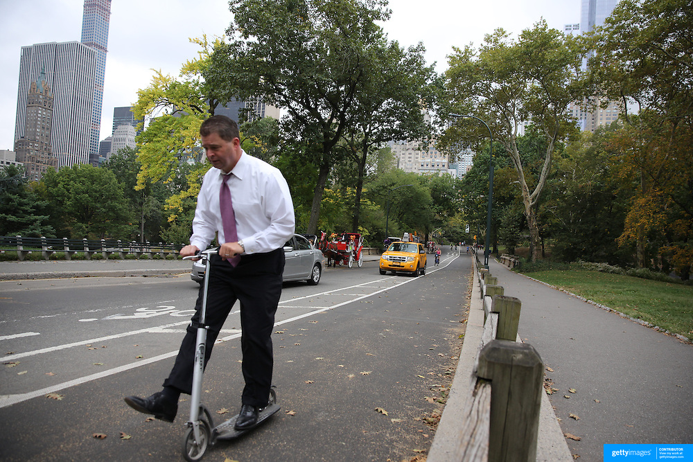 A scooter riders in Central Park, Manhattan, New York, USA. Photo Tim Clayton