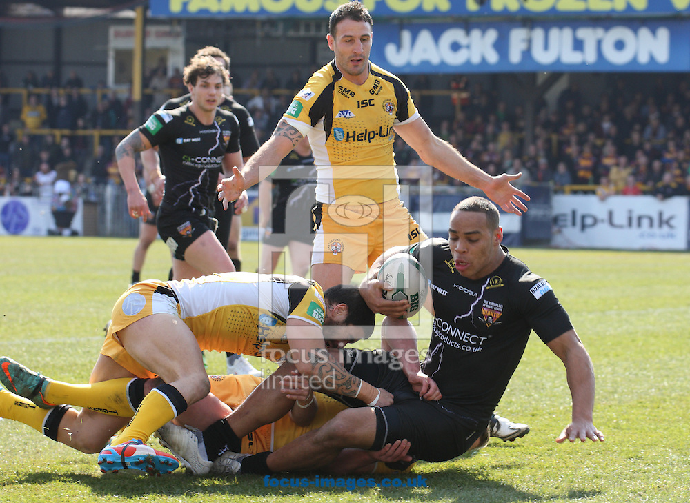 Picture by Stephen Gaunt/Focus Images Ltd +447904 833202.06/04/2013.Rangi Chase (Left) of Castleford Tigers makes the tackle on Leroy Cudjoe (right) of Huddersfield Giants during the Super League match at the PROBIZ Colliseum, Castleford.