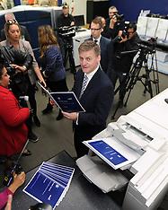 Petone-Finance Minister Bill English checks Budget 2015 at printers