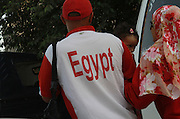 An Egyptian couple with a young child crossing the road in Cairo , Egypt May 23, 2012. Egyptians voted  Wednesday for an historic opportunity in which they will for the first time to pick their president in a wide open election that pits Islamists against men who served under deposed leader Hosni Mubarak.(Photo by Heidi Levine/Sipa Press).