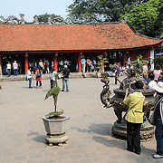 Tourists in one of the courtyards of the Temple of Literature in Hanoi. The temple was built in 1070 and is one of several temples in Vietnam which are dedicated to Confucius, sages and scholars.