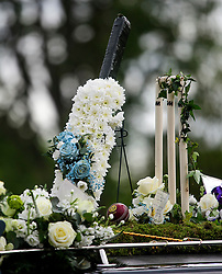 © Licensed to London News Pictures. 05/05/2017. London, UK. Flowers in the shape of a cricket bat and wickets, on the roof of the funeral procession as it arrives at the crematorium. The funeral of Westminster Terror attack victim Leslie Rhodes takes place at North East Surrey Crematorium in Morden, South London. Leslie Rhodes, who was Winston Churchill's former window cleaner, suffered serious injuries when terrorist Khalid Masood mowed down and killed 4 pedestrians on Westminster Bridge before attacking and killing a police officer with a knife.  Photo credit: Ben Cawthra/LNP