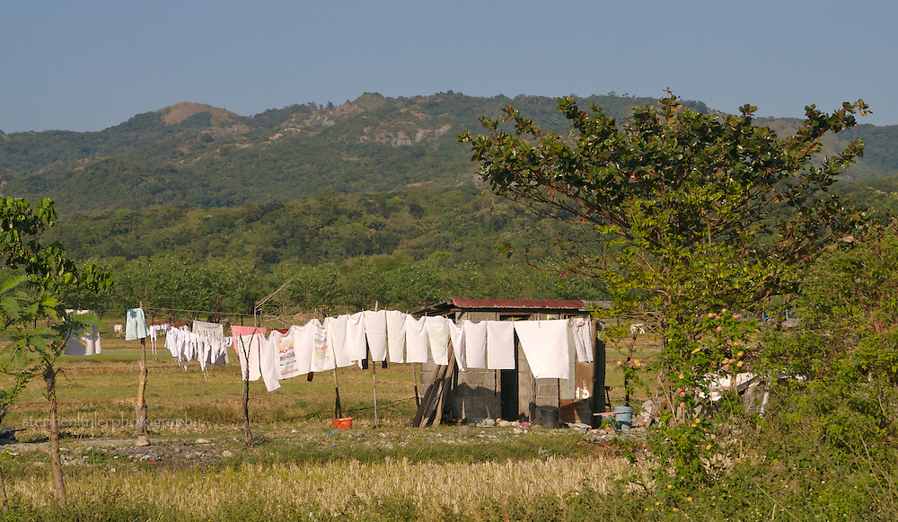 Laundry hangs out to dry in the countryside near the salt making area of Pasuquin in Ilocos Norte, The Philippines.