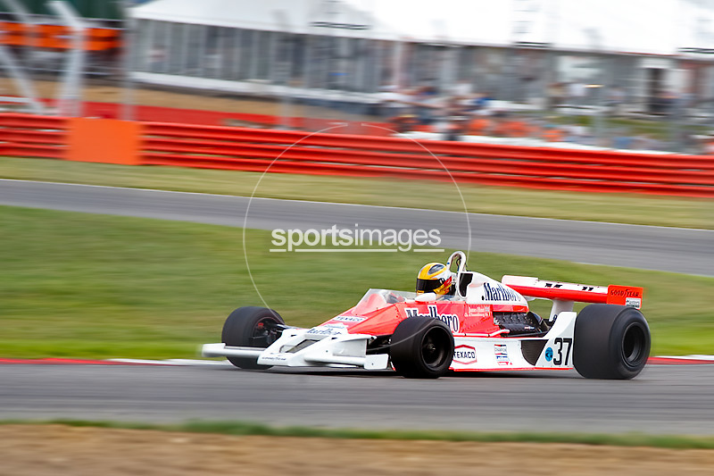 Car No 37 heads around Luffield. Silverstone Classic - 66-85 F1- 25/7/10.