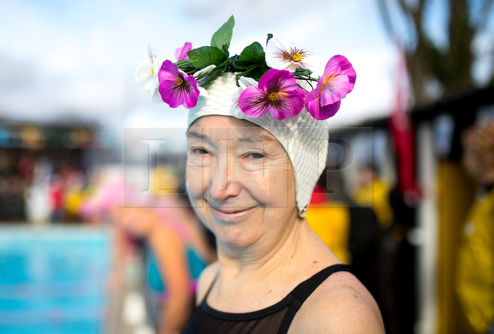 © Licensed to London News Pictures. 28/01/2017. London, UK. Swimmers compete in the 'Best Hat' competition at the 7th UK Cold Water Swimming Championships, taking place at Tooting Bec Lido. Ice in the Lido has only recently thawed following freezing temperatures in London over the past week. Temperatures in the pool today at 1 degree celsius. Photo credit : Tom Nicholson/LNP