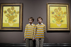 Van Gogh's Sunflowers at National Gallery. Twins Edgar and Gabriel pose during a photo-call of Vincent Van Gogh's Sunflowers exhibition.A pair of the five surviving versions of Vincent Van Gogh's iconic Sunflowers are displayed together at the National Gallery in London. The paintings were last seen in London together 65 years ago. United Kingdom. Friday, 24th January 2014. Picture by Peter Kollanyi / i-Images