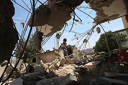 August 16, 2017 - Ramallah, West Bank, Palestinian Territory - A boy walks next to the remains of the family house of Palestinian assailant Omar Alabed after it was demolished by Israeli troops in the West Bank village of Khobar near Ramallah.  (Credit Image: © Shadi Hatem/APA Images via ZUMA Wire)