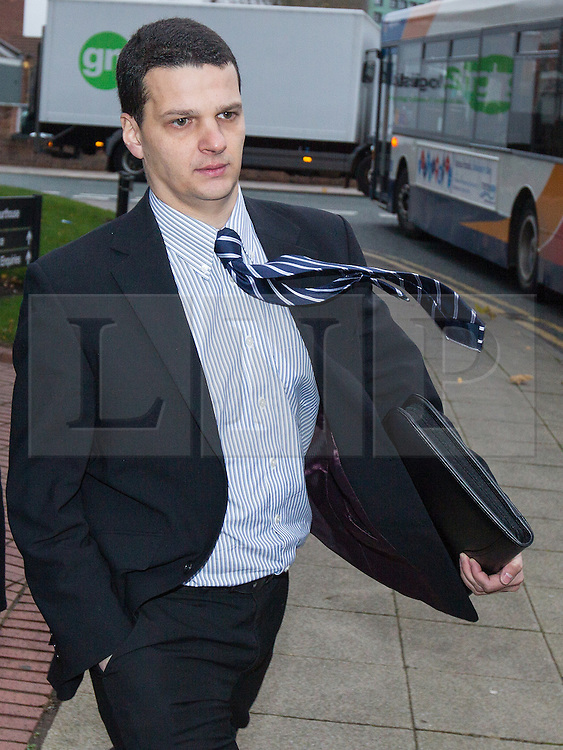 © Licensed to London News Pictures . 05/12/2013 . Stockport , UK . FA referee DEAN MOHAREB leaves Stockport Magistrates Court this morning (5th December 2013) . Mohareb is charged with perverting the course of justice and unauthorised access to computer data . Photo credit : Joel Goodman/LNP