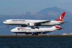 Boeing 777-3F2(ER) (TC-LJB) operated by Turkish Airlines landing past Boeing 747-436 (G-CIVG) operated by British Airways, San Francisco International Airport (KSFO), San Francisco, California, United States of America