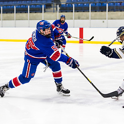 TORONTO, ON  - OCT 29,  2017: Ontario Junior Hockey League game between the Toronto Jr. Canadiens and the Toronto Patriots, Chase Spencer #55 of the Toronto Jr. Canadiens shoots the puck during the third period. <br /> (Photo by Catherine Kim / OJHL Images)