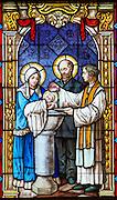 Therese's baptism. (Sam Lucero photo)