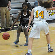 Trask's Qua Schaffer drives on Topsail's Carmen Pyrtle Friday December 5, 2014 at Topsail High School in Hampstead, N.C. (Jason A. Frizzelle)