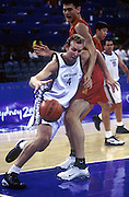 Tall Black forward Sean Marks gets around Yao Ming during the basketball match between New Zealand and China at the Olympic Games, Sydney Australia, 2000. Photo: PHOTOSPORT<br />