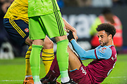 Felipe Anderson (West Ham) being helped to his feet during the Premier League match between West Ham United and Arsenal at the London Stadium, London, England on 9 December 2019.