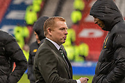 Celtic Manager Neil Lennon talks with Christopher Jullien of Celtic FC at a rainy National Stadium ahead of the Betfred Scottish League Cup Final match between Rangers and Celtic at Hampden Park, Glasgow, United Kingdom on 8 December 2019.